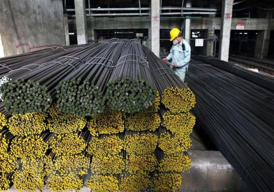 An employee is at work at a steel mill in Vietnam - PHOTO: VNA
